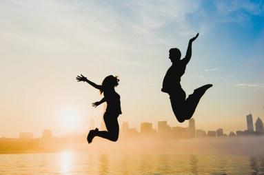 jumping celebration couple